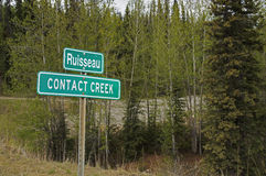 Alaska Highway Sign Contact Creek Stock Photo