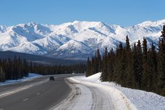 Alaska highway in the winter. Driving to the north of Alaska Stock Image