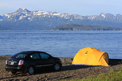 Alaska - Homer Spit Beach Tent Camping. Many visitors to Homer, Alaska choose to camp, either in recreational vehicles, campers, or in this case car tent camping Royalty Free Stock Images