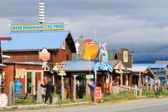 Alaska - Homer Spit Shops and Tours. A view of visitors and tourists checking out some of the tour offices and gift shops along the world famous Homer Spit in Royalty Free Stock Image