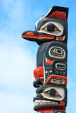 Alaska Huna Tlingit Totem Pole Art. Part of a totem pole that marks the front entrance of the Icy Strait Point Huna Tlinget Cultural Center Theater near Hoonah Stock Photos