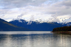 Alaska Inside Passage. Springtime view of snow capped mountains from Alaska's inside passage Royalty Free Stock Image