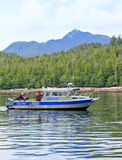 Alaska Ketchikan Salmon Charter Fishing Boat. A charter fishing boat trolling for salmon in the Inside Passage near Ketchikan, Alaska royalty free stock photography