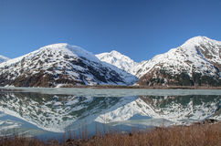 Alaska lake and snow covered mountains Stock Photography