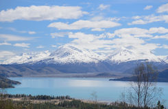 Alaska lake and snow covered mountains Stock Photo