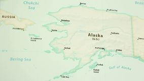 Alaska on a map with defocus. Alaska on a political map of the world. Video defocuses showing and hiding the map stock video