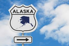 Alaska map and state flag on a USA highway road sign. With sky background royalty free stock photography