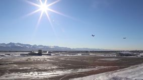 ALASKA, MARCH 2017, Two aircrafts fly curve over airport. US Air Force. Two C-130 transport aircraft fly a curve over an airport in Alaska stock footage