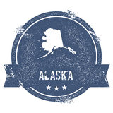 Alaska mark. Travel rubber stamp with the name and map of Alaska, vector illustration. Can be used as insignia, logotype, label, sticker or badge of USA state stock illustration