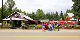 Alaska Mountain High Pizza Pie Talkeetna. Summer visitors pass by the popular Mountain High Pizza Pie restaurant in downtown Talkeetna, Alaska. Talkeetna, a Royalty Free Stock Photos