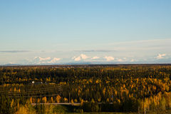 The Alaska Range in Autumn. The Alaska mountain range rises above the fields and forests surrounding Fairbanks in autumn Stock Photography