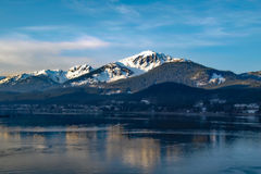 Alaska Mountain And Sea. Beautiful mountain protruding upwards as viewed from the sea royalty free stock image