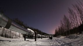 The Alaska Pipeline at Midnight in Fairbanks stock images