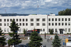 The Alaska Railroad Depot in Anchorage. The Anchorage Depot was built in 1943, has a 1907 preserved locomotive steam engine on pedestal in front of building, and Royalty Free Stock Images