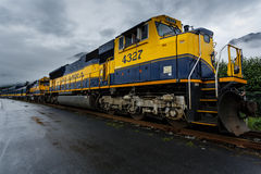 Alaska railroad engine and snowplow pulling long train Royalty Free Stock Photos