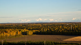 The Alaska Range. The Alaska mountain range rises above the fields and forests surrounding Fairbanks Royalty Free Stock Image