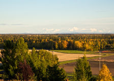 The Alaska Range in Autumn. The Alaska mountain range rises above the fields and forests surrounding Fairbanks in autumn Royalty Free Stock Photos