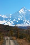 Alaska Range and hilly road in Denali NP Stock Images