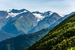 Alaska`s Chugach Mountains on the Kenai Peninsula. The snowcapped mountains of Alaska`s Chugach Mountain Range on the Kenai Peninsula stock image