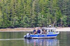 Alaska Salmon Charter Fishing Boat Ketchikan. A charter fishing boat trolling for salmon in the Inside Passage near Ketchikan, Alaska stock photography
