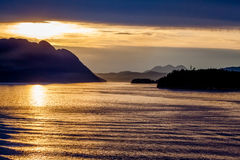 Alaska Scenery. Horizontal sunset image of Alaska mountain range and waterway taken on August 20, 2011, from a cruise ship en route to Vancouver, Canada, from stock images