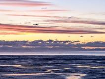 Alaska Seashore - Dramatic Clouds (plane taking off) Stock Image
