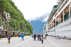 Alaska Skagway Railroad Dock Cruise Ships. Passengers make their way back to thier Royal Caribbean cruise ships Rhapsody of the Seas and Radiance of the Seas Royalty Free Stock Image