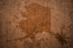 Alaska state map on a old vintage paper background Stock Photography