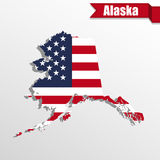 Alaska State map with US flag inside and ribbon Stock Image