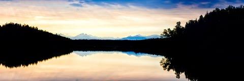 Alaska sunrise. A stitched panorama of a sunrise on Lake Stephen near Big Lake, Alaska Stock Image