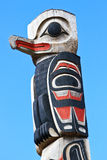 Alaska Tlingit Totem Pole Top. Part of a totem pole that marks the front entrance of the Icy Strait Point Huna Tlinget Cultural Center Theater near Hoonah Royalty Free Stock Photography