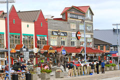 Alaska Tourist Shopping in Downtown Ketchikan. A view of downtown the waterfront shops popular with tourists with coming Ketchikan, Alaska. A popular summer stock image