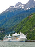 Alaska - Two Cruise Ships in Skagway. The Royal Caribbean Radiance of the Seas (front) and Rhapsody of the Seas (rear) cruise ships tied up at the Railroad dock Royalty Free Stock Photos