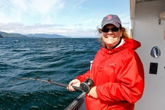 Alaska -  Woman Halibut Fishing Royalty Free Stock Photo
