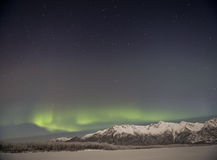 Alaskan Aurora. The Aurora shine over an Alaskan mountain range Stock Photos
