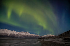 Alaskan Aurora. The Aurora shine over an Alaskan mountain range Royalty Free Stock Images