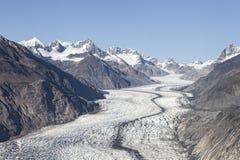 Alaskan glacier in summer. McBride glacier in Glacier Bay in Alaska on a sunny day from the air Royalty Free Stock Images