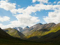 Alaskan Landscape. Beautiful Alaskan tundra with mountains and dramatic sky Royalty Free Stock Image