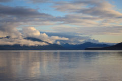 Alaska Scenery. Horizontal image of Alaska mountain range from cruise ship at sunset stock photo