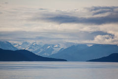 Alaskan Mountain Range. Landscape view of Alaska mountain range from cruise ship at dusk Royalty Free Stock Photography