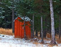 Alaskan outhouse in the snow Royalty Free Stock Photography
