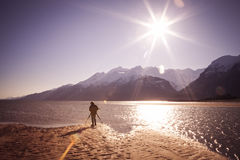 Alaskan Photographer on Sunny Beach Stock Image