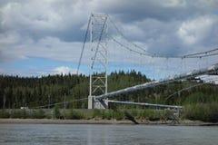 The alaskan pipeline crossing a river. The famous oil pipeline crossing the river at delta junction, alaska Stock Image