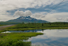 Alaskan pond. And mountain landscape Royalty Free Stock Photo