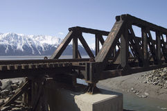 Alaskan Railroad trestle. A railroad trestle in Alaska with the Alaskan mountain range in background Royalty Free Stock Photos