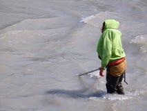 An alaskan resident dip-netting for salmon Royalty Free Stock Image