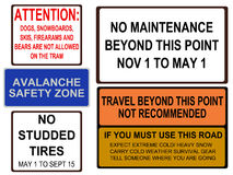 Alaskan road signs. Studded tires and extreme cold warnings Stock Photography
