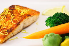 Alaskan salmon. Fine salmon plate with steamed vegetables garnished with lemon slices Stock Photography