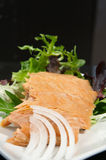 Alaskan smoked sockeye salmon. Starter on a bed of lettuce stock image