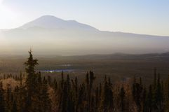 Alaskan sunrise. Sunrise in Alaska in early December.  You can see an icy fog in the distance Stock Image
